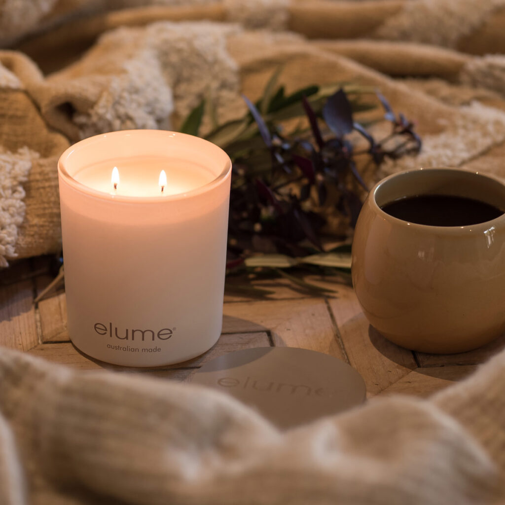Elume Luxury Soy Candle and Coffee Cup Winter Social Image